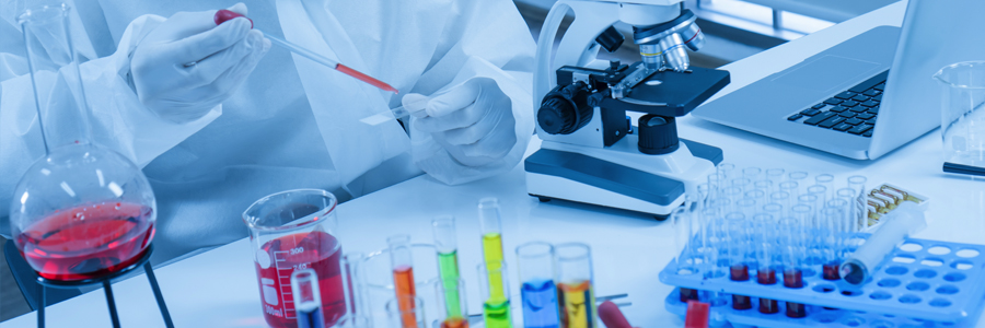 image of a lab with test tubes and microscope